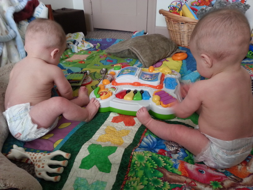 back of twin babies in diapers