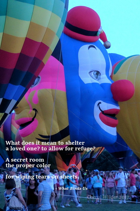 closerup air balloons with clown faces