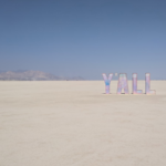 nevada desert with blue sky and word art y'all