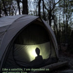 silhouette of child in tent at dusk