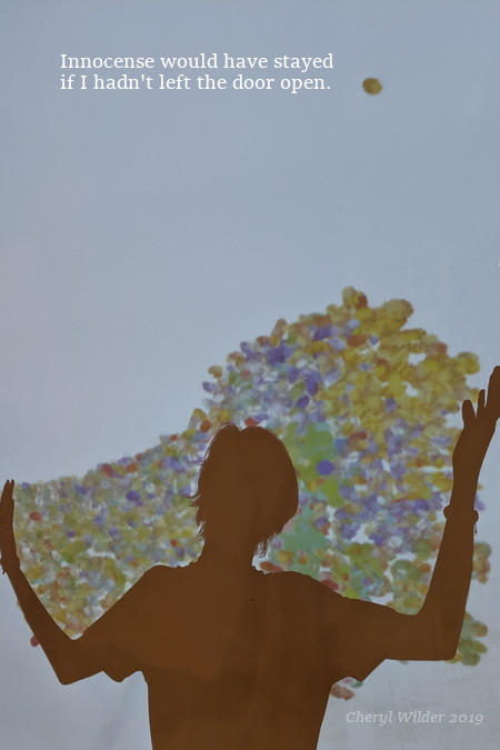 silhouette of young man with his arms cradling colorful balls on a digital screen