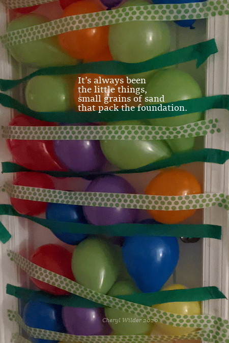 balloons held to a door with crepe paper